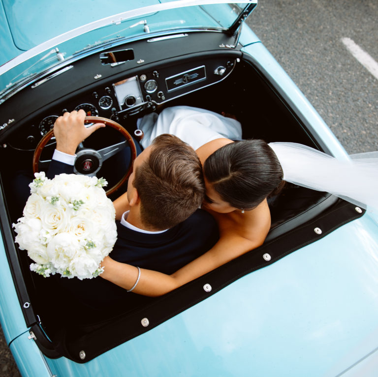 wedding couple in downtown portland in a vintage car